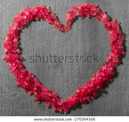 Close up image of sea salt for spa in heart shape - stock photo