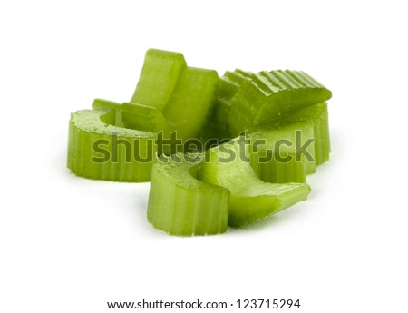 Close-up image of slices of celery scattered on a white background
