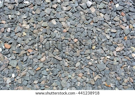 Close up image of small grey rocks for background. - stock photo