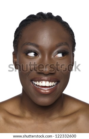 Close-up image of smiling African woman looking at the side over the white background - stock photo