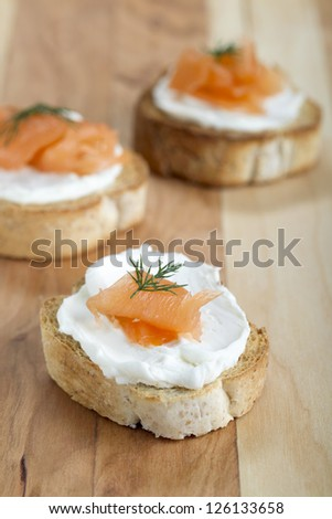 Close up image of smoked salmon with cream cheese on piece of bread