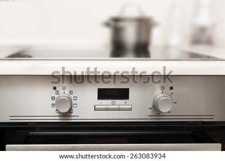 Close up image of stainless steel cooker controls - stock photo