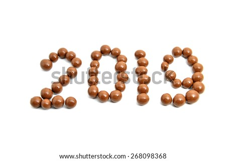 Close-up image 2019 of sweet chocolate round on a white background. Slightly defocused and close-up shot.