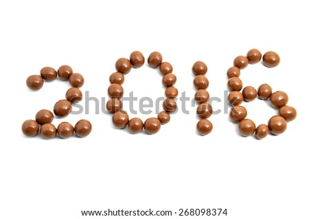 Close-up image 2016 of sweet chocolate round on a white background. Slightly defocused and close-up shot.