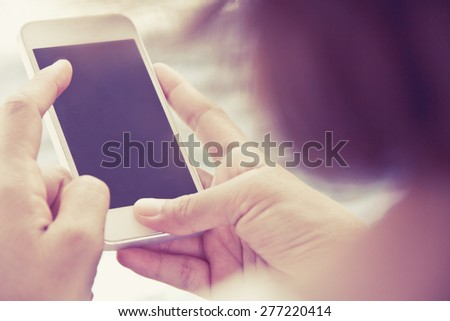 Close up image of Teenage girl text messaging on her phone - stock photo