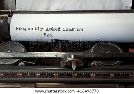 close up image of typewriter with paper sheet and the phrase: frequently asked questions faq. copy space for your text. retro filtered  - stock photo