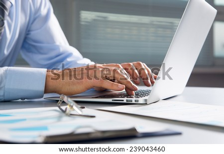 Close-up image of typing male hands at laptpp - stock photo