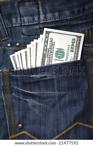 Close up image of US dollars in blue jeans` pocket