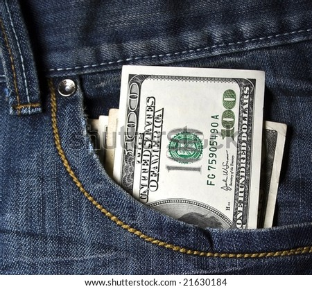 Close up image of US dollars in blue jeans` pocket - stock photo