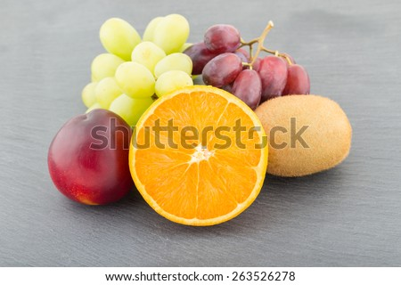 Close up Image of Various Fruits on a Slate Board  - stock photo