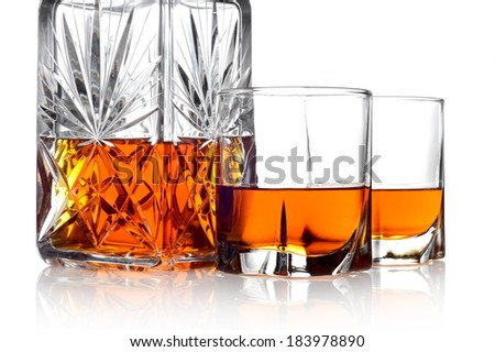 Close-up image of whisky in a carafe and two glasses isolated on white