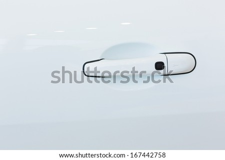 Close up image of white car door handle - stock photo