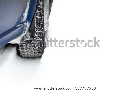 Close-up Image of Winter Car Tire on the Snowy Road with Space for Your Text. Drive Safe Concept - stock photo