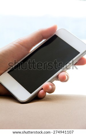Close up image of Woman hand holding a Smart Phone