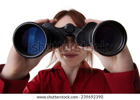 close up image of woman looking through binoculars - stock photo