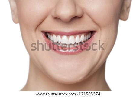 Close up image of woman with toothy smile against white background - stock photo