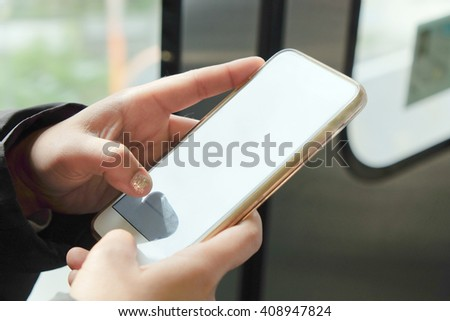 Close up image of women text messaging on her phone - stock photo