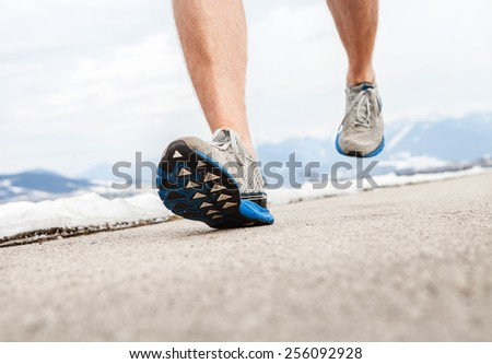 Close up image runner legs in running shoes