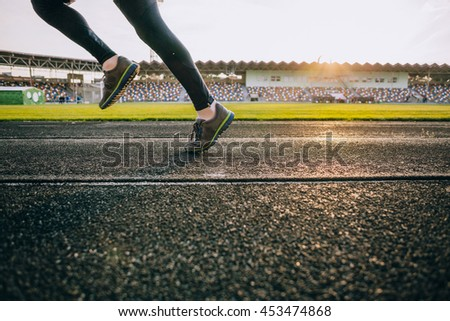 Close up image runner legs on track