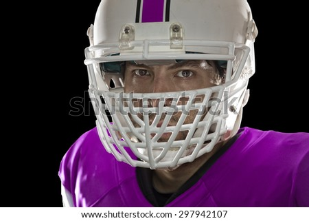 Close up in the eyes of a Football Player with a pink uniform on a black background.