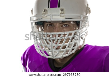 Close up in the eyes of a Football Player with a pink uniform on a white background.