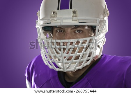 Close up in the eyes of a Football Player with a purple uniform on a purple background.
