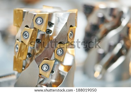 Close-up industrial milling metal cutting tool with carbide cutter insert bit - stock photo