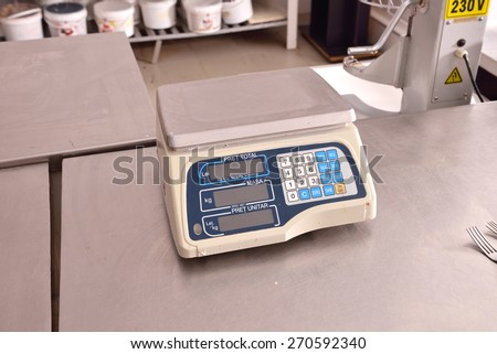 close up industrial scales in the kitchen of a restaurant - stock photo