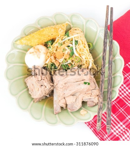 Close up Instant noodle Spicy rib pork with chopstick on white background.  - stock photo