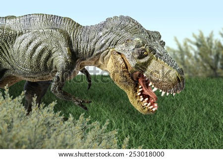 Close up Isolated dinosaur on green grass background - stock photo