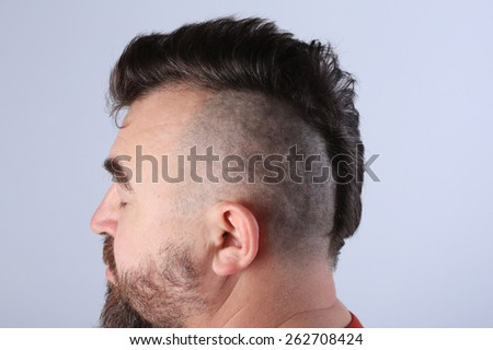 close-up isolated mohawk hairstyle on the head of white men with black hair, studio - stock photo