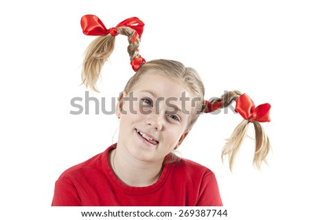 Close-up isolated portrait of a pretty Caucasian girl in pigtails