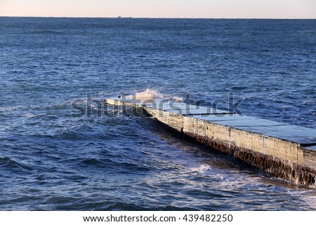 close-up isolated sea waves breaking on the breakwater