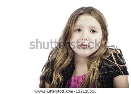 Close up isolated shot of a little girl looking sad, sick or in trouble - stock photo