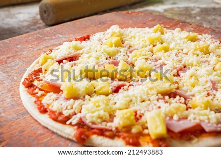 Close up italian pizza uncooked in kitchen