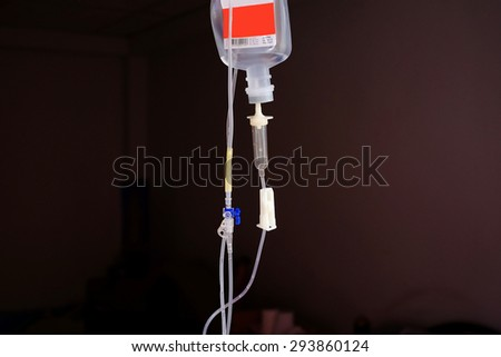 Close up IV saline solution drip for patient in hospital - stock photo