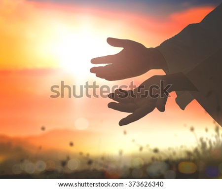 Close up Jesus Christ hands open palm up on blurred sunset background. Mercy Humble Reconcile Adoration Glorify Christmas Blessed God Help Christian Muslim Ramadan Kareem Sun Son Need Soul concept - stock photo