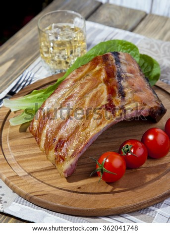 Close up Juicy Grilled Pork Rib Meat on Top of Wooden Cutting Board