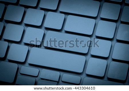 Close-up laptop keyboard no letters. Toning is blue. - stock photo