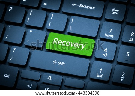 Close-up laptop keyboard. The focus on the Recovery key. Toning is blue. - stock photo