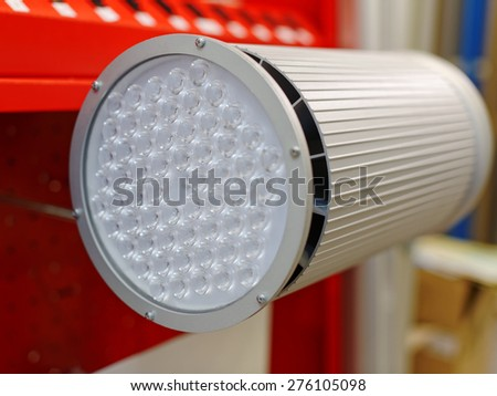 Close-up. Large gray spotlight with round glass. - stock photo