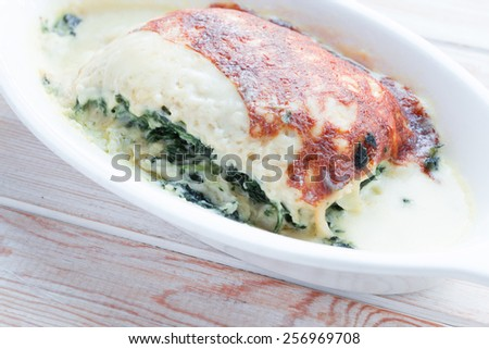 Close up lasagna spanish on wood table - stock photo