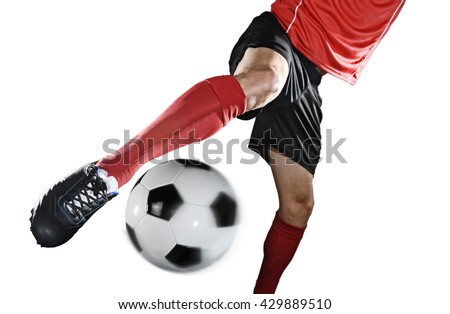 close up legs and soccer shoe of football player in action kicking ball isolated on white background wearing red jersey and sock - stock photo