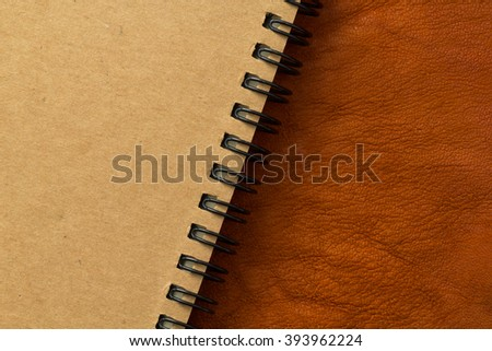 close up light tan cover book place on leather background - stock photo