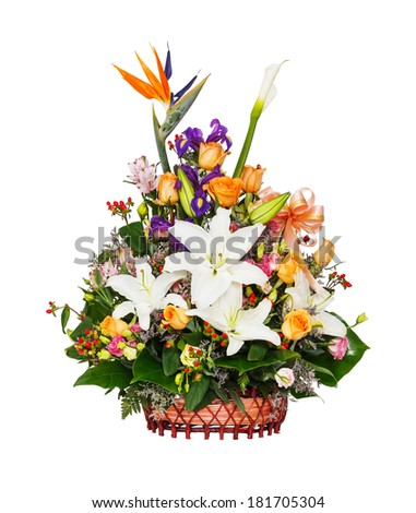 Close up lily - rose - berry - alstroemeria troika - iris - bird of paradise - caspia flower bouquet in wicker basket isolated on white - stock photo