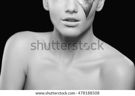 Close-up lips and shoulders of caucasian girl with bright creative professional make-up. Natural skin. Studio portrait. Black and white