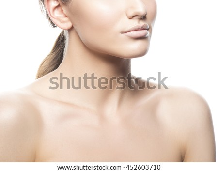 Close-up lips and shoulders of young caucasian brunette woman with natural lips, make-up, perfect skin and blue eyes look up. Isolated on white background. Studio portrait.  - stock photo