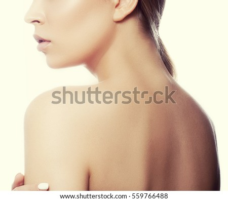 Close-up lips and shoulders of young caucasian girl with green eyes, natural lips, makeup and blonde hair. Woman portrait. Toned