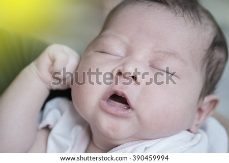 Close up Little baby cute is lying in bedroom. Asian baby.Vintage or retro tone. - stock photo
