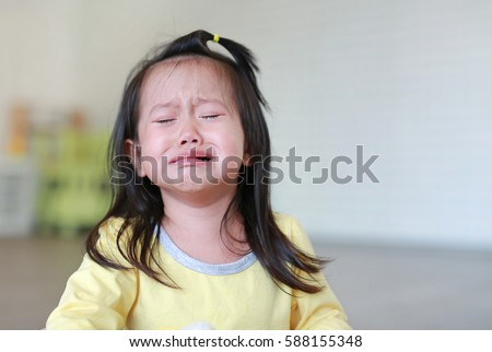 close up little kid girl crying with tearful on her face